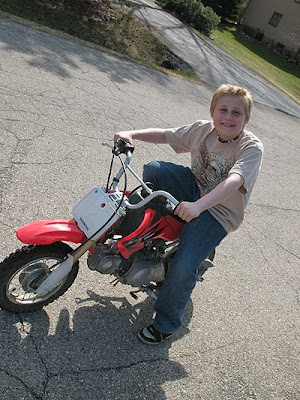couple of the kids on the dirt bikes in our neighborhood. more later :)