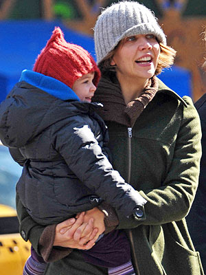 Maggie Gyllenhaal totes 2-year-old Ramona as she makes her way to the
