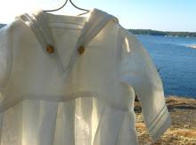 Dopklänning i lin i Sjömansmodell