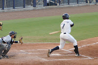Leslie Anderson's three run blast sparked the 5 run rally that led the Biscuits to victory.  Photo by Jim Donten.