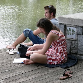 A young couple relaxing in Piedmont Park