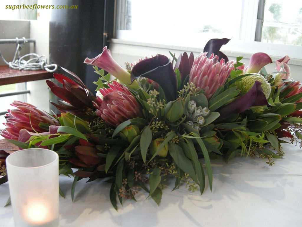 Natives and callas Head table arrangement