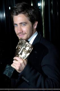 Jake Gyllenhaal holds his BAFTA for the camera