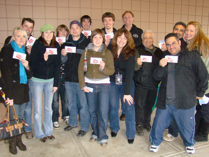 "Listeners show off their coupons for ""FRONT ROW"" seats!"
