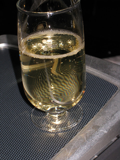 Champagne is served as welcome drink on JL061