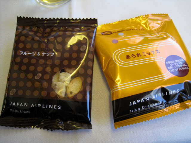 Rice crackers and nuts packages in JAL Business Class