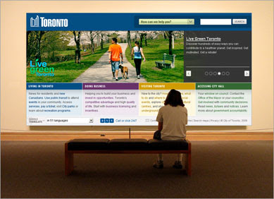 person sitting in front of large painting of toronto.ca front page