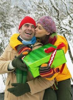couple at Christmas sharing Christmas presents