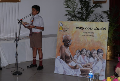 A schoolboy reading excerpts from the book, a man called Bapu