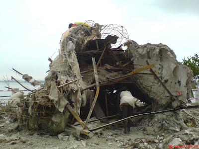 Ganesha idol being dismantled