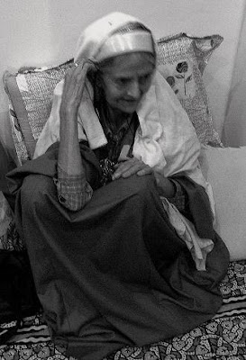 old lady in traditional Kashmiri pandit dress: Tarang, pheran,