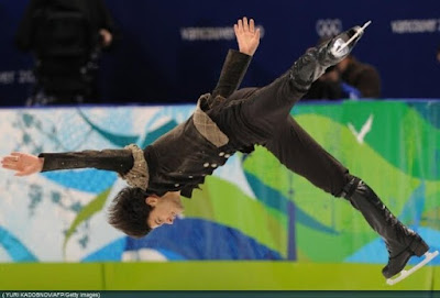 Stephane Lambiel Olympic figure skater men's short program screencaps images spin photo pictures screengrabs video capture