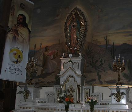 imagen del indio Juan Diego en el Tepeyac, ante la Madre de Dios