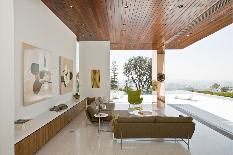 Ceiling To Floor Movable Glass Walls Open The Expansive Space Outdoor Terrace And Its Infinity Saltwater Pool Cool White Terrazzo Interior Floors
