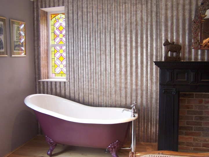 Through the round window contemporary indian window for for Corrugated iron bathroom ideas