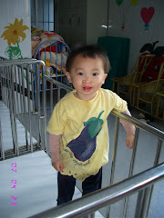 Just Received this Picture of Abbie While she was Still in Shantou.  Love the Eggplant Shirt!