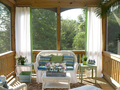 screened porch with curtains