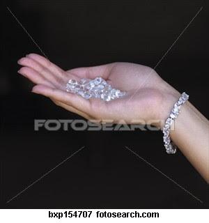 Woman s Hand Holding Diamonds