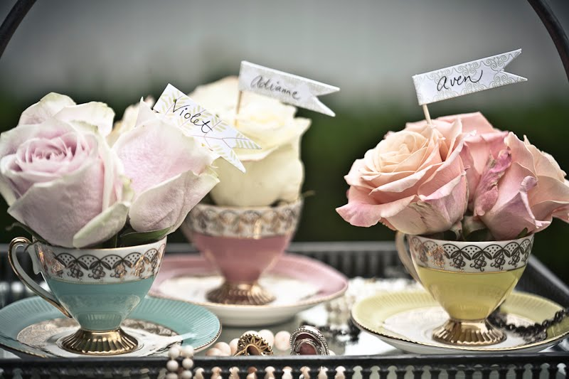 these dainty tea cups above make perfect place card holders and favors for the guests jpg
