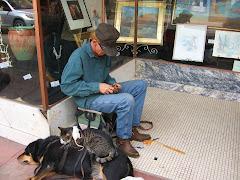 Homeless man...working