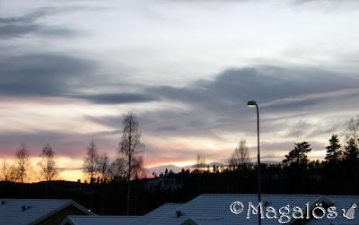 Solnedgång med fina moln.
