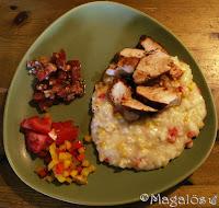 Tallrik med kyckling och risotto.