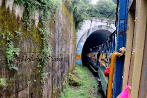 Toy train entering one of the tunnels