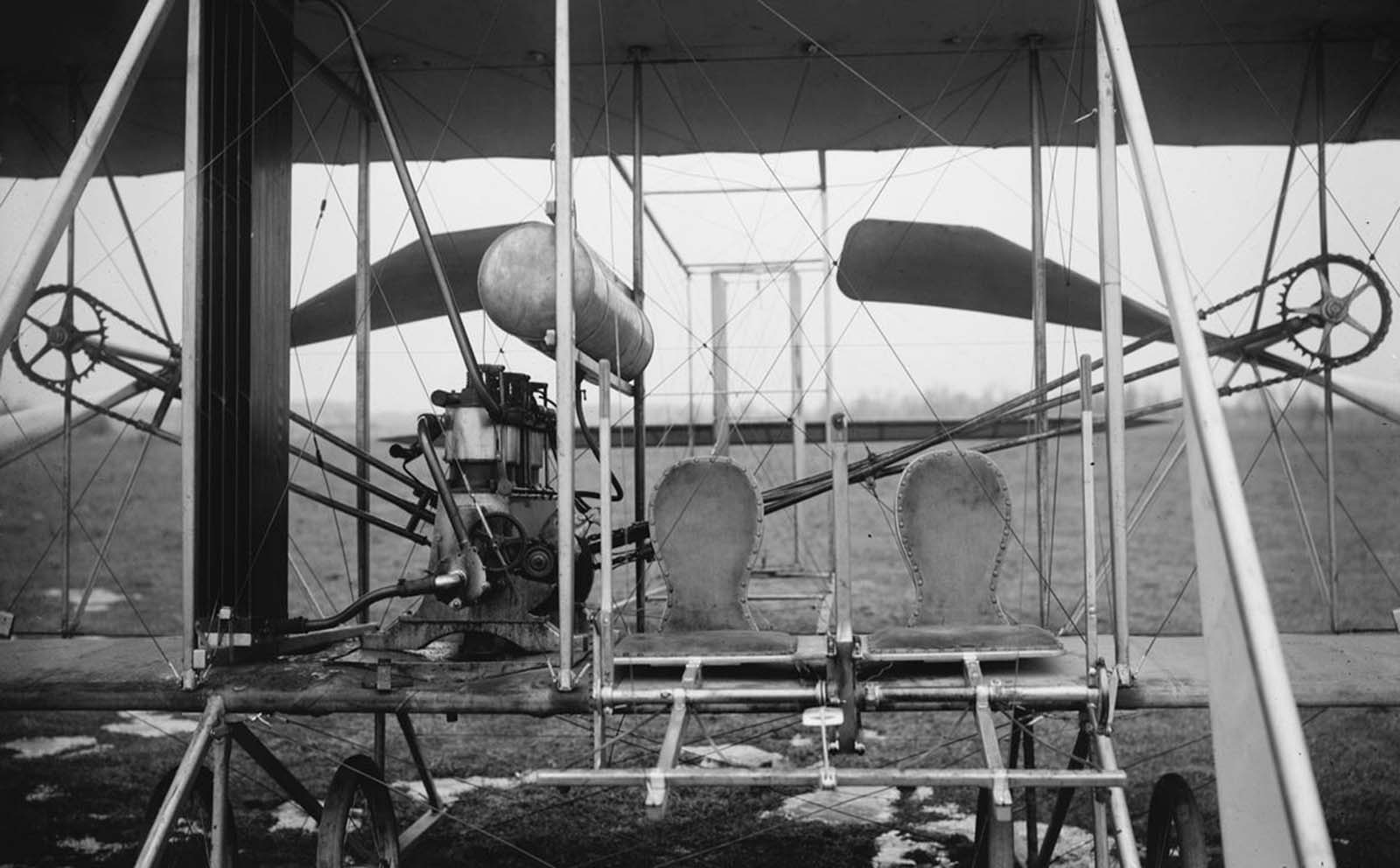 Close-up view of a Wright airplane, including the pilot and passenger seats, 1911.