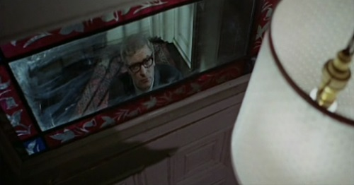 Michael Caine looking up through a window
