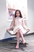 Girl in Dress Sitting Down