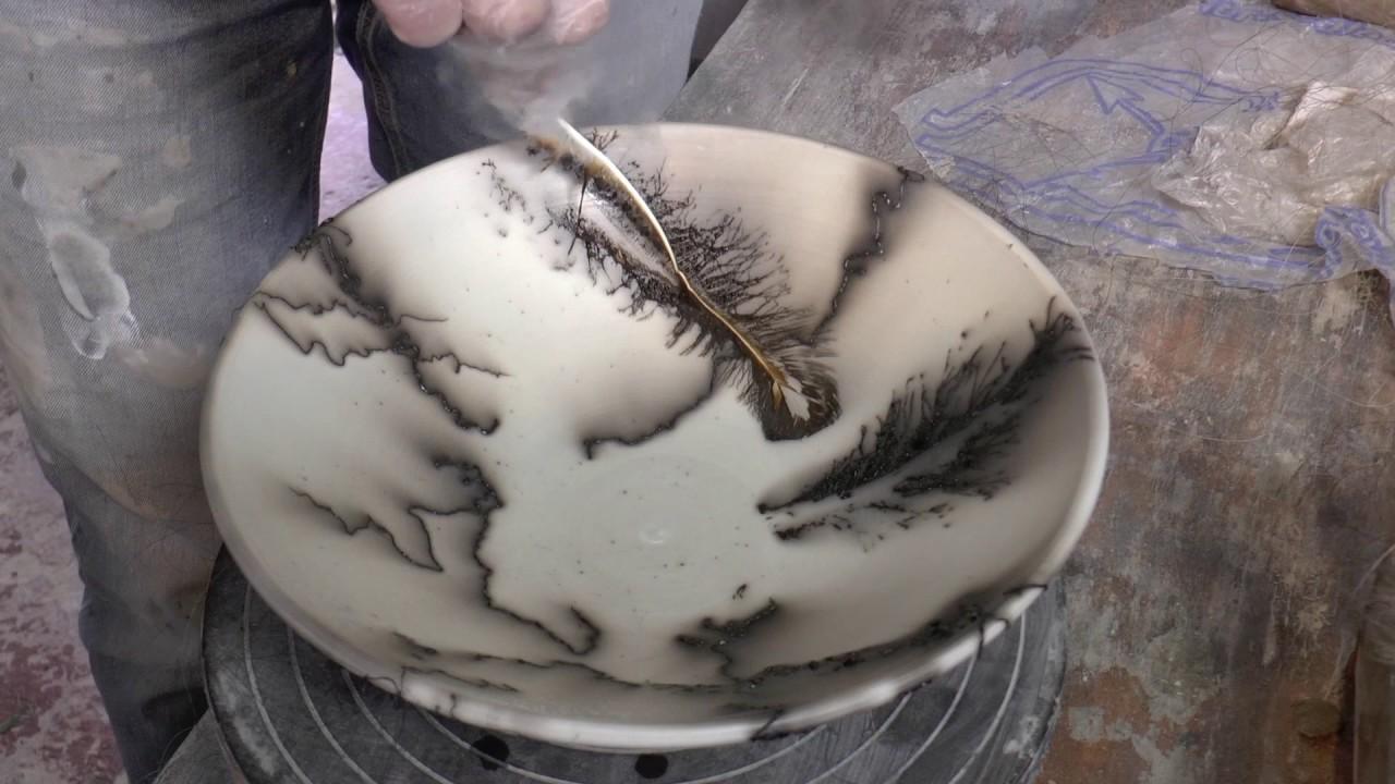 Creative Hub: Artist smokes feather onto pottery