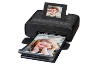 Canon Selphy CP1200 Picture Printer in Black-The Canon Selphy CP1200 is a wireless photo printer that can publish from clever devices. Merely connect your clever tool by means of the app and you're good to go to publish lab-quality variations of your Instagram breaks in much less compared to a minute.