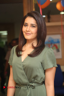 Actress Raashi Khanna Stills in Green Short Dress at Mirchi 95 Suno Aur Mercedes Jeeto Contest  0025.JPG