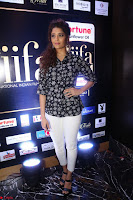 Ritika Singh in Black Printed Shirt and White Leggings at IIFA Utsavam Awards press meet 27th March 2017 04.JPG