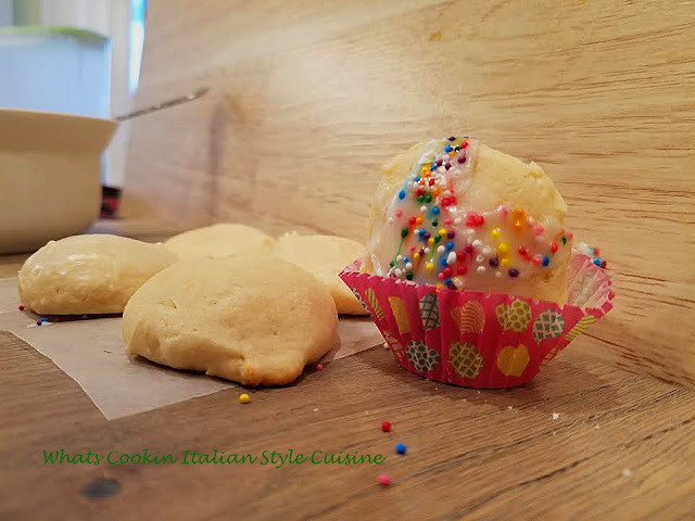 cookies made with ricotta and lemon frosted with sprinkles