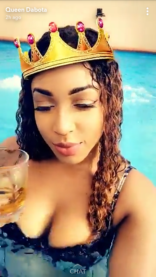 Dabota Lawson flaunts major cleavage as she hits her home pool