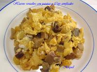 Huevos revueltos con patatas y Ceps confitados