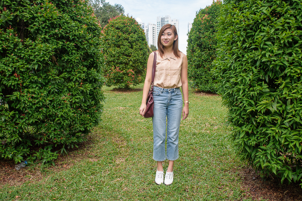 Carina chung lean in ootd with green shrubs