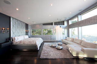 Sensational White Modern Sofa Bed in the Bedroom with Wide Bed and the Grey Padded Headboard
