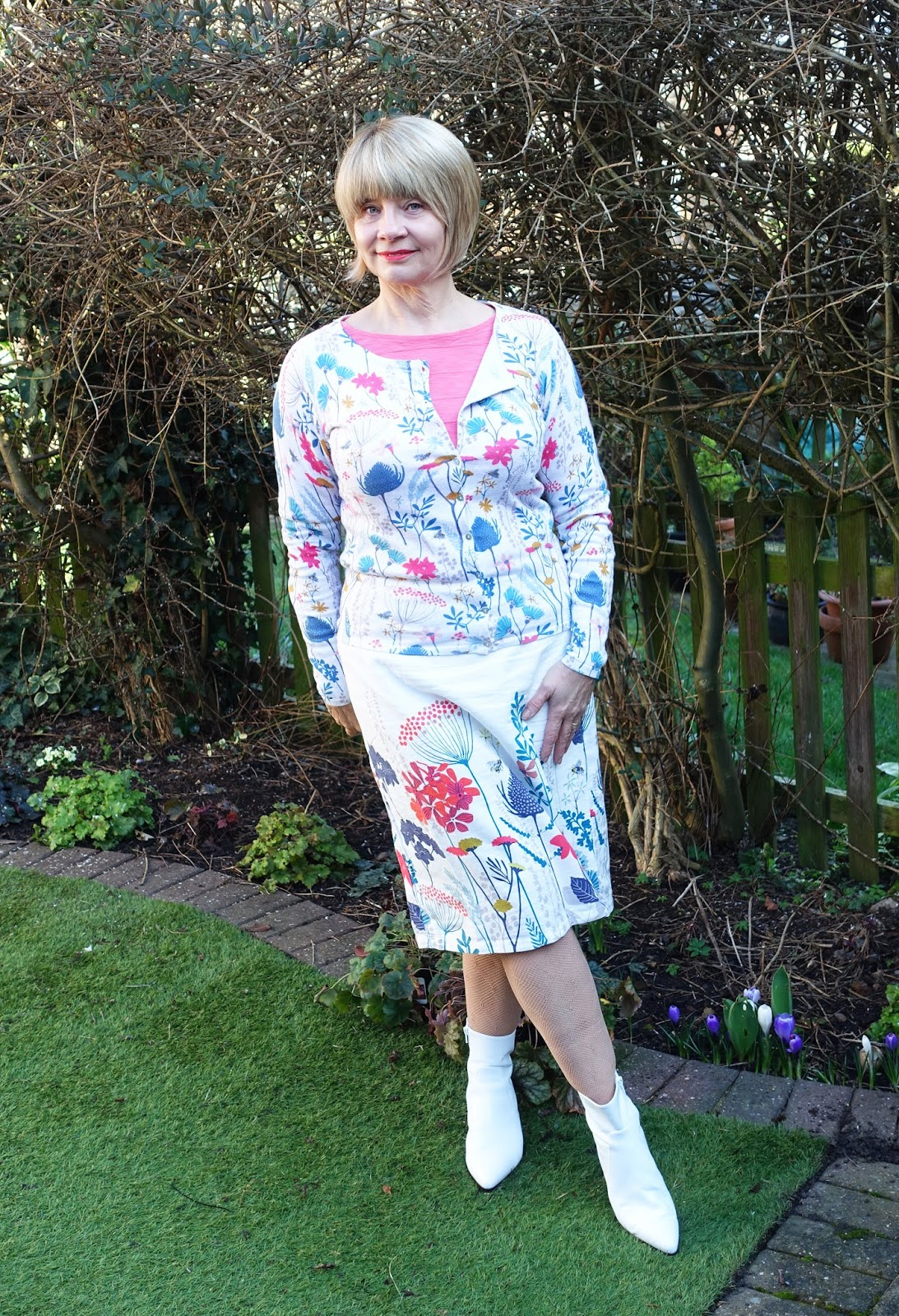 Over-50s blogger Gail Hanlon in floral patterned skirt, cardigan and coral top from UK family business Lily and Me