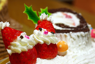strawberry and cream santas on yule log