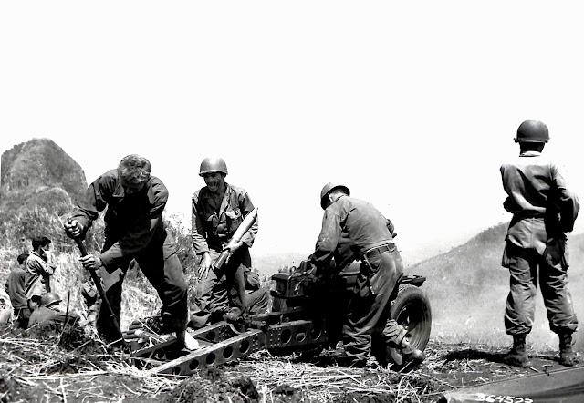US Army soldiers firing artillery at cave in Lipa, Batangas in 1945.  Image source:  United States National Archives.