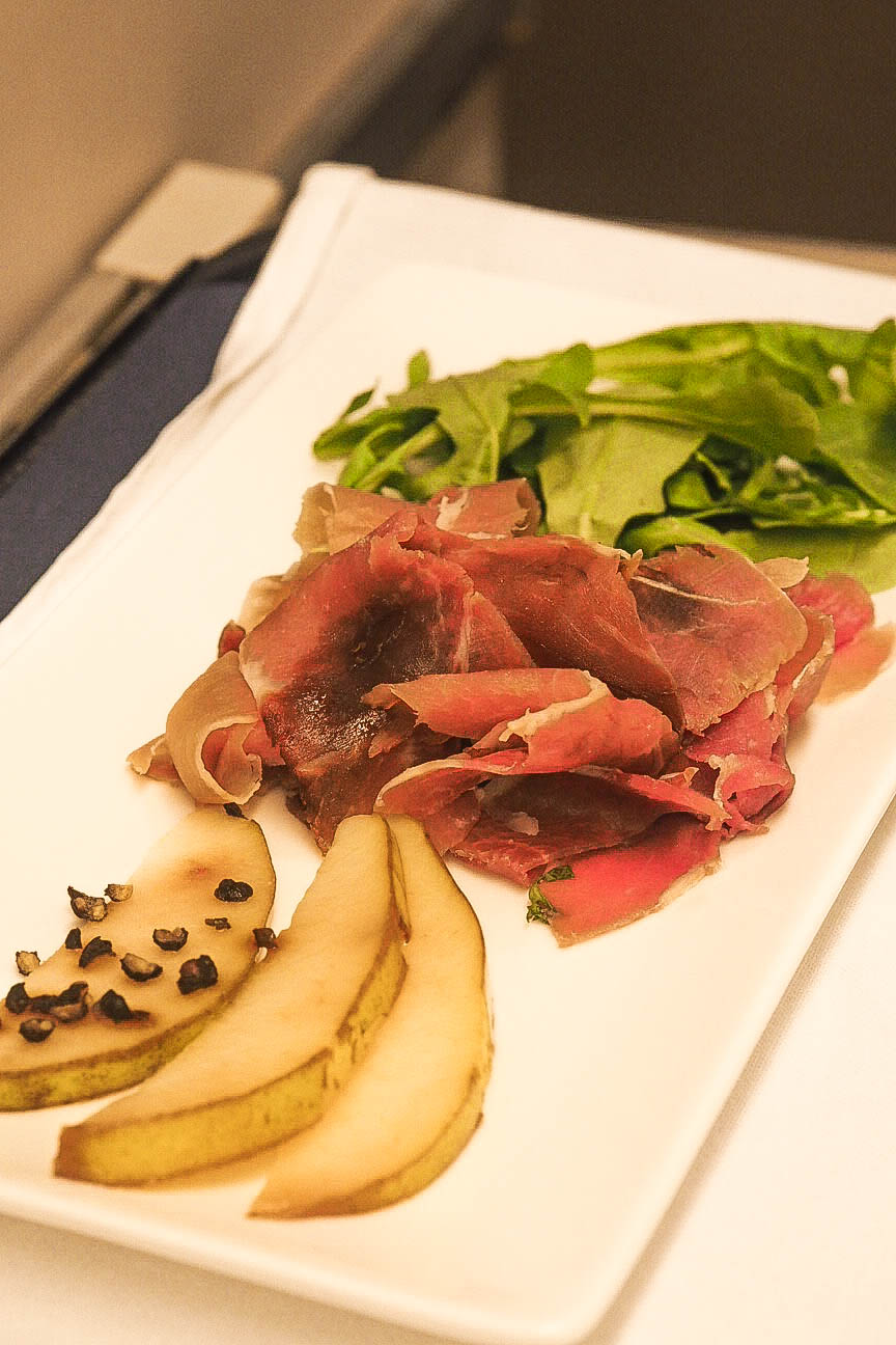 Prosciutto with pickled Bosc pear, rocket salad, cracked black pepper and red wine reduction