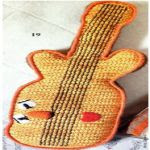 http://www.crochetkingdom.com/crochet-guitar-toy-pattern/