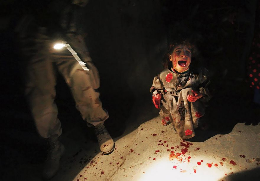 #44 Iraqi Girl At Checkpoint, Chris Hondros, 2005 - Top 100 Of The Most Influential Photos Of All Time