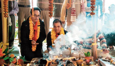 Mann Ghisingh offers prayers at a temple in Rohini