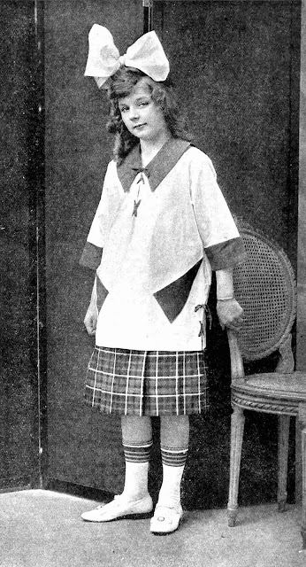 a 1918 photograph of an odd girl who's too old for her clothes, from a clothing catalog