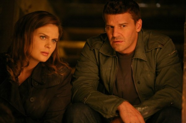Bones - Dr. Brennan and Agent Booth sit together in a storm shelter