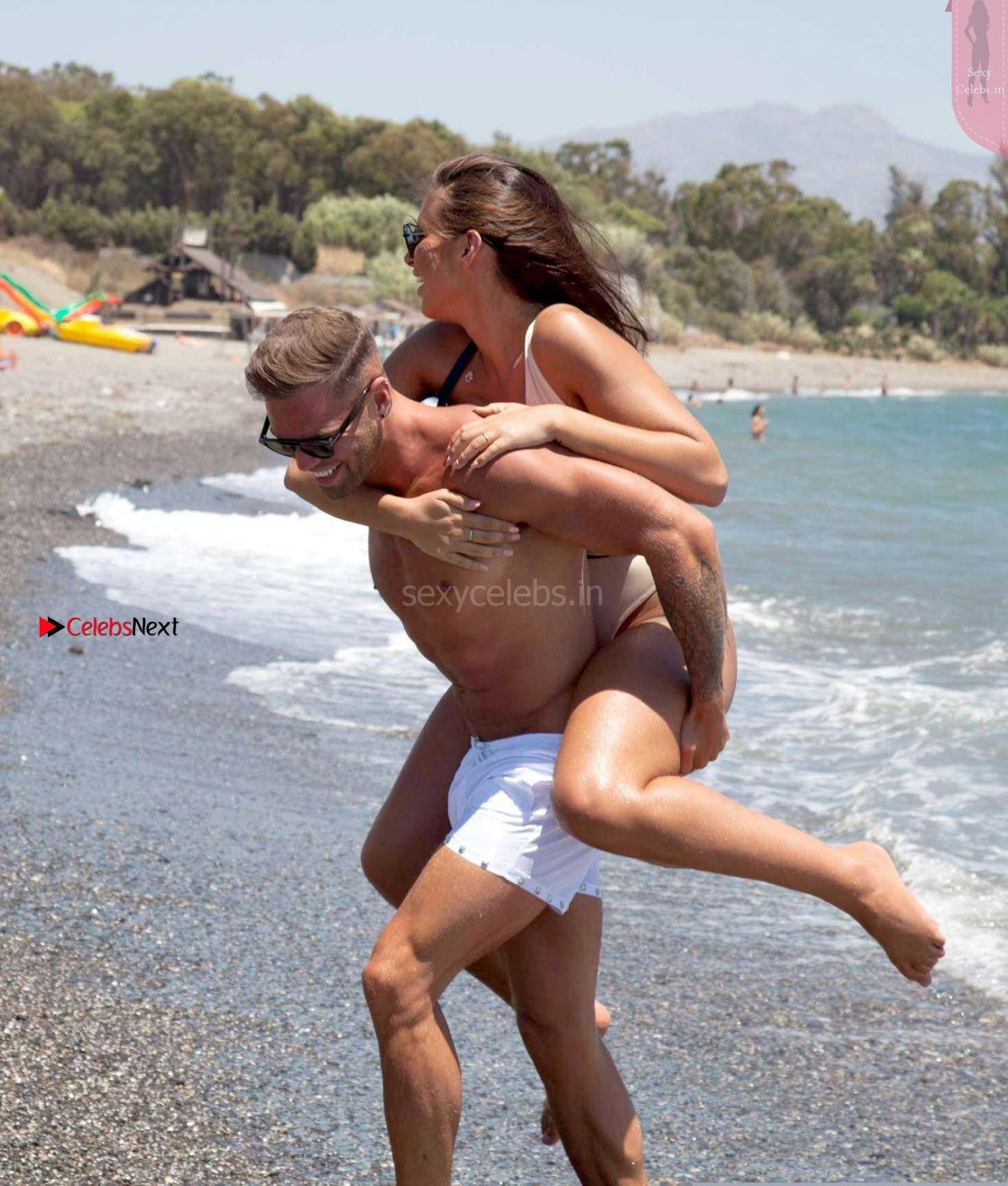 Jessica Sheers busty babe in bikini having sex with her boy friend in bikini on beach wow August 2017