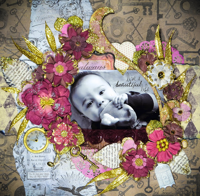 Always Live a Beautiful Life Scrapbook Page Layout With handmade cloisonne flowers in pink and gold against kraft background with metal embellishments, gold clock, music note, key, sparkle glitter leaves, birdcage, Prima marketing flowers and leaves.
